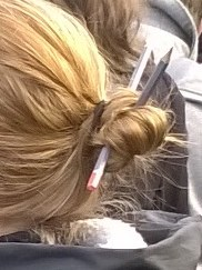 Woman wearing pencils in her hair